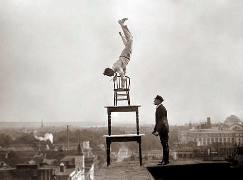 man-balancing-on-chair